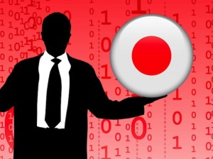 Businessman-Holding-China-and-Japan-Internet-Flag-Buttons